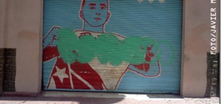 """Mural de Radamés """"Juni"""" Figueroa que muestra a Carlos Arroyo en esta foto se presenta vandalizado ."""